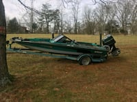 green and brown boat and black boat trailer 367 mi