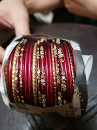 red and gold-colored bangles