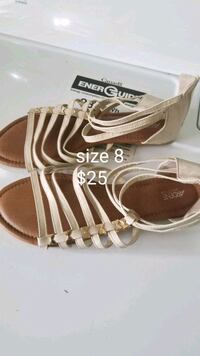 pair of brown-and-white leather sandals Sooke, V9Z 1K1