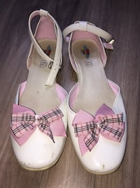 pair of white leather open-toe ankle strap heels Toronto, M9C 4X5