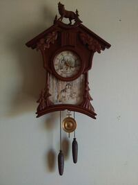 brown wooden wall mounted clock