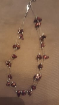 red beaded silver-colored necklace