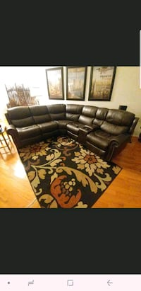 black leather sectional sofa with throw pillows 592 mi