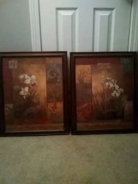 two brown wooden framed painting of flowers Cleveland, 37323