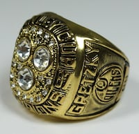 diamond gold-colored champion ring