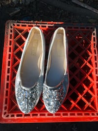 pair of gray leather flats 951 mi
