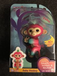 pink and blue Fingerlings Baby Monkey toy pack