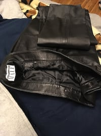 Black leather slim pants for men waist size 36  brand new....I was used one time.... New York, 11223