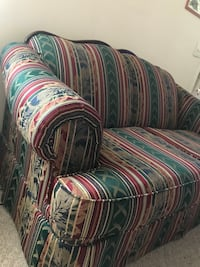 Green and red fabric loveseat