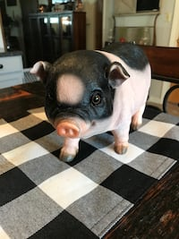 PIG STATUE   11  1/2. Inches long. 7 1/2 Tall
