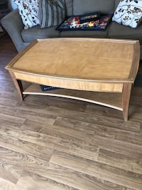 brown wooden framed glass top coffee table Las Cruces