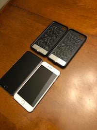Silver and pink phones with battery charger, charger, usb cable (no headphones)