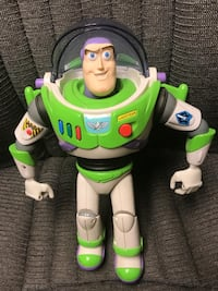 """This is one of the first talking action Buzz Lightyear in mint condition. Has working lights and sounds, and is posable. 13"""" tall and is mint condition   Ronkonkoma, 11779"""