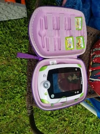 Leap frog explorer w/5games. Works great