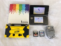 Black nintendo ds with game cartridges Hamilton, L8V 2W2