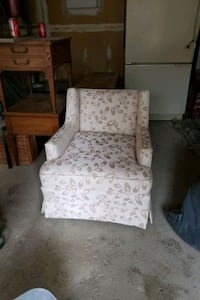 white and gray floral padded armchair