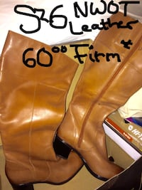 pair of brown leather zipped knee high boots