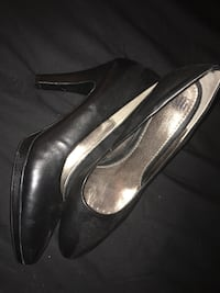 pair of black and silver leather stiletto