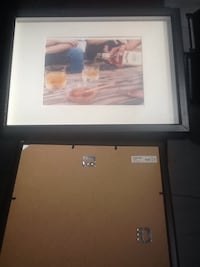 White and brown wooden IKEA picture frame   547 km
