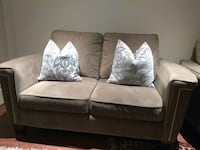 gray suede loveseat with two throw pillows Quebec, H8Y 2L2