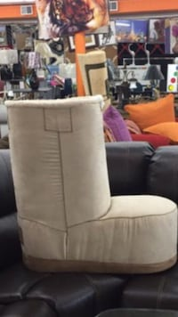 Beige ugg suede boot couch