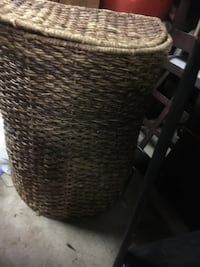 Wicker hamper with attached lid