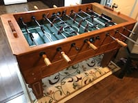 brown and black foosball table Vancouver, V5R 3W3
