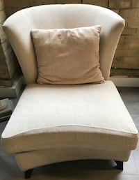 beige fabric sofa chair with beige pillow WOODBRIDGE