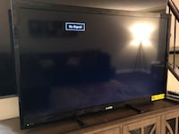 black flat screen TV with remote Upper Marlboro, 20772