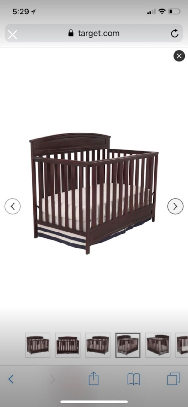 Brown wooden crib in excellent condition