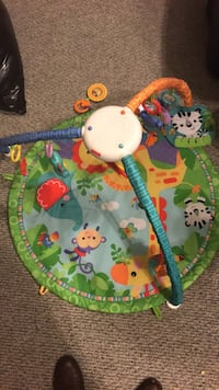 baby's green, blue, and orange zoo print activity gym