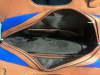 blue and brown zippered bag