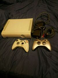 white Xbox 360 console with two controllers 2301 mi