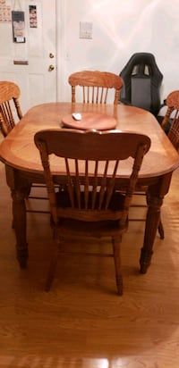 oval brown wooden dining table with chairs set Northbridge