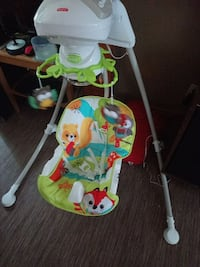 white, red, and green Fisher-Price portable swing Ange-Gardien, J0E 1E0