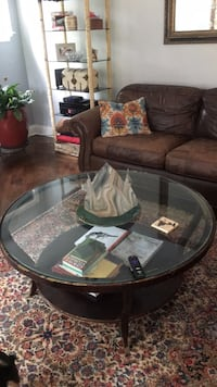 round brown wooden framed glass top coffee table Camillus, 13031
