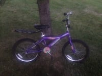 Purple and black bicycle