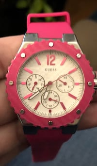 round pink chronograph watch with red strap Calgary, T1Y 3L2