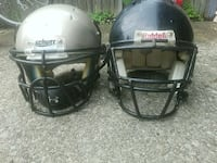 two gray and black Riddell football helmets Cleveland, 44128
