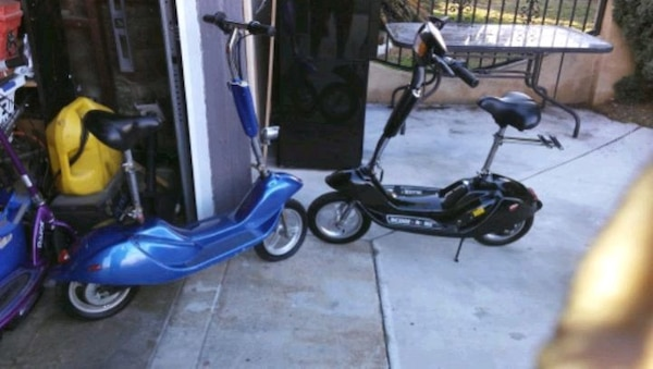 Sit Down Scooter >> Used Blue 24 Volt Electric Sit Down Scooter And Black O For Sale In