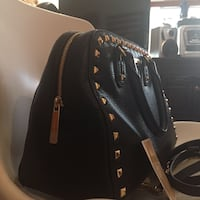 Black leather studded tote bag Micheal kors. Pre owned in perfect condition