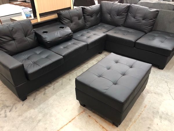 Solid black leather tufted sofa sectional