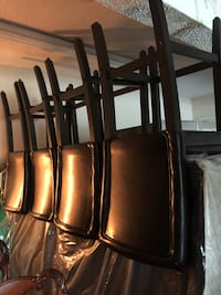 5 Brown leather barstools. Sold in package deal or separately  Metairie, 70003