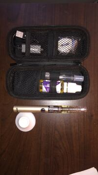 gold-colored vaporizer pen with pouch