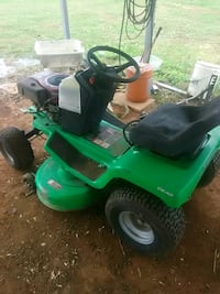 green and black ride-on mower North Wilkesboro, 28659