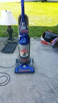 blue and gray upright vacuum cleaner Conroe, 77385