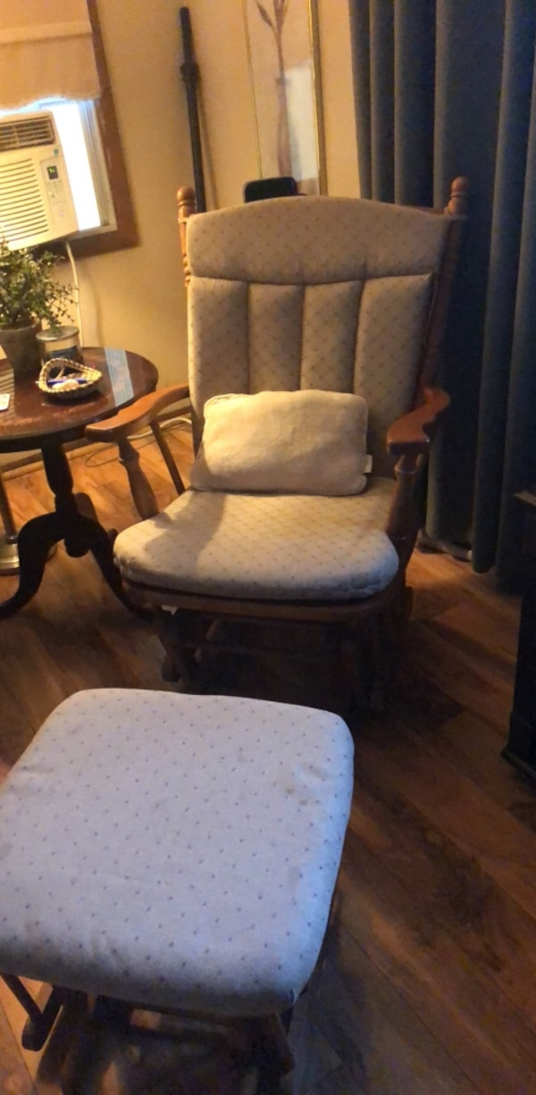 two white padded brown wooden armchairs