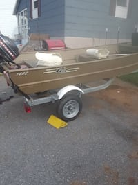 brown and white boat trailer 35 km