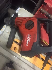 Red and black milwaukee power tool 230 mi