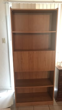 Brown wooden 4-shelves bookcase